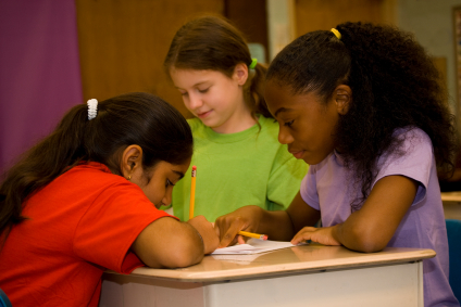 Three children work together during class